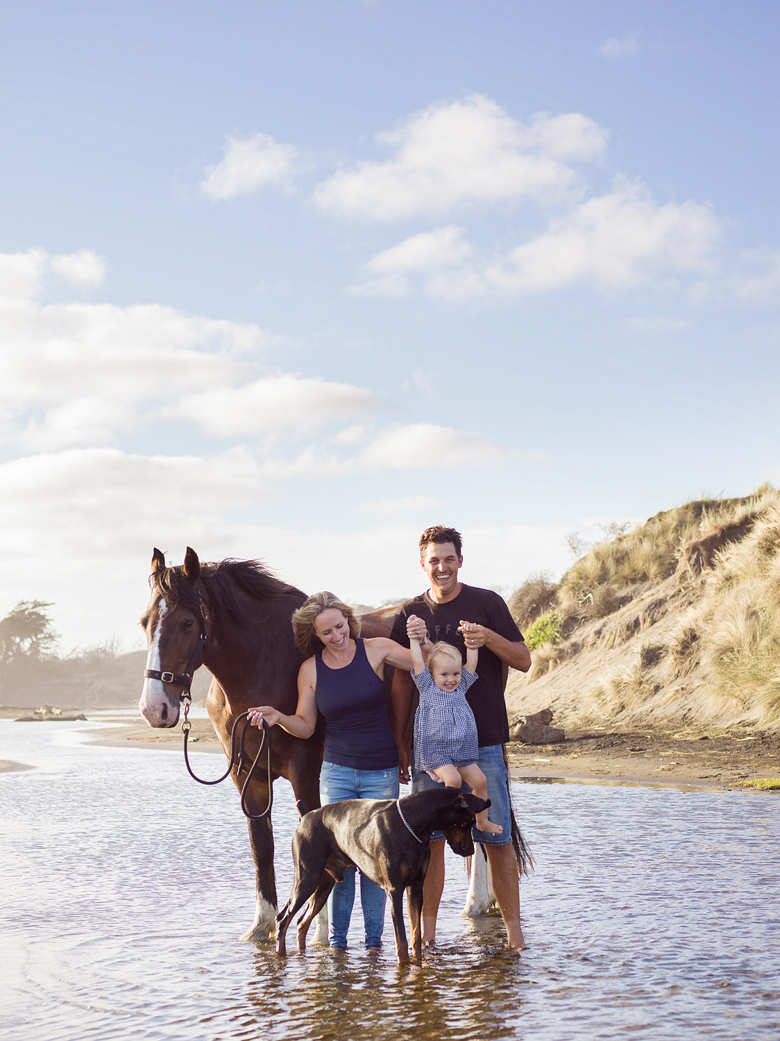 Family Portrait of couple with daughter, Horse and Dog on Beach